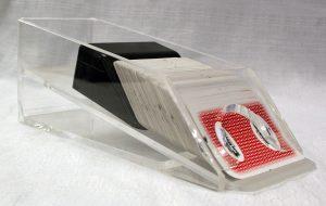 """Clear """"card dealer shoe"""" or holder."""