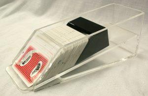 "Side view of clear ""card dealer shoe"" or holder."