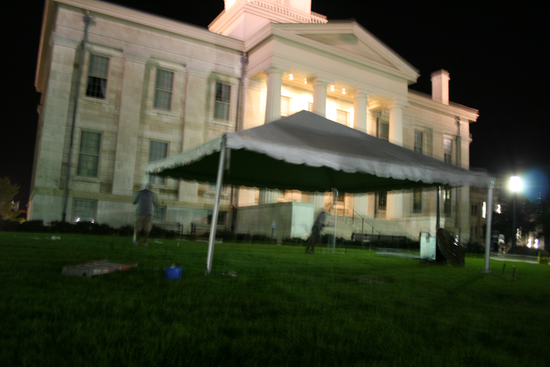Frame tent on the lawn of Iowa Old Capitol Building