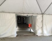 Inside enclosed motorcade tent with walkway.