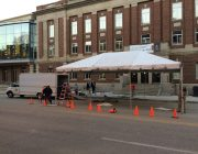 Constructing a fully enclosed structure for a motorcade for Michelle Obama and Rep. Bruce Braley.