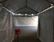 Inside enclosed motorcade tent tunnel's walkway.
