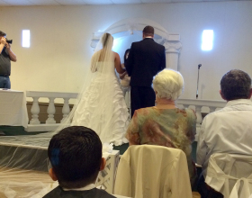 Diana and Michael Bowen saying there vows at their wedding.