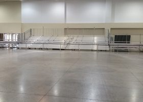 45′ towable hydraulic bleacher flanked by two 5-row bleachers