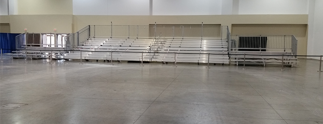 Bleachers and Pipe and Drape set-up for Indoor Gymnastic Event