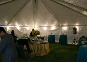 Inside heated tent with lights and power outlets for event.
