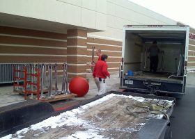 Last delivery of belt style stanchions for crowd control at Target for Black Friday.