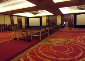 Setting up the Model Runway for Iowa Wedding Expo