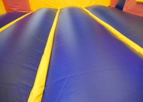 Bounce floor area inside Birthday cake bounce house and slide combo