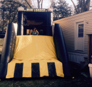 Combo bounce house and slide inflatable mini loader front with kids playing.