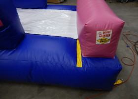 Exit of Birthday cake bounce house and slide combo