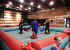 Guys at 30hop duke it out on inflatable game