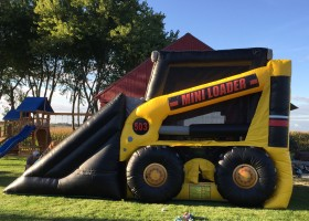 Side of mini loader inflatable combo bounce house and slide showing door entrance