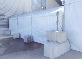 Blocks on 30′ x 30′ losberger clearspan tent at 2015 Iowa Ag Summit
