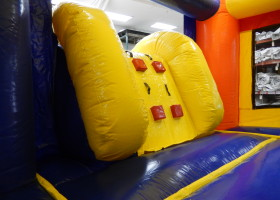 Climb to get to the slide inside the mini rainbow bounce house and slide combo