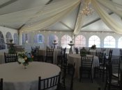 Inside 40′ x 60′ jumbo track tent at grand opening with french windows