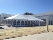 Outside view of 40′ x 60′ jumbo track tent at grand opening