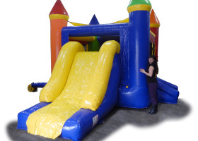 View of mini rainbow bounce house and slide combo with Ruby Heck
