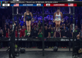 Female competitors doing muscle-ups