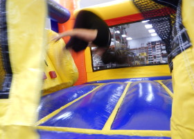 Front flip inside mini rainbow combo bounce house and slide