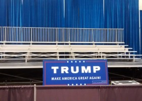Elevated bleachers two 5-row bleachers side by side pipe and drape at Trump political event in Dubuque, Iowa