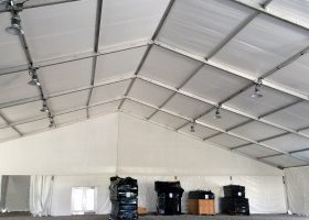 Under 100′ x 131′ clear span tent with high-bay lighting