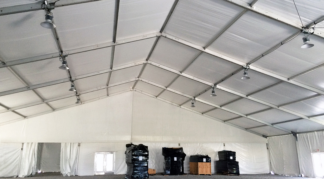 Under 100' x 131' clear span tent with high-bay lighting