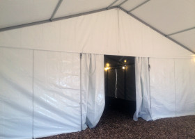 Under 30′ x 50′ clear span tent with interior gable wall