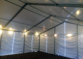 Under 30′ x 50′ clear span tent with perimeter lighting