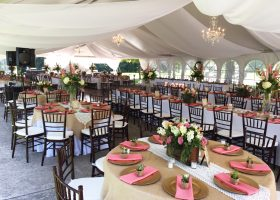 Wedding reception tent with sheer drape tables and chairs