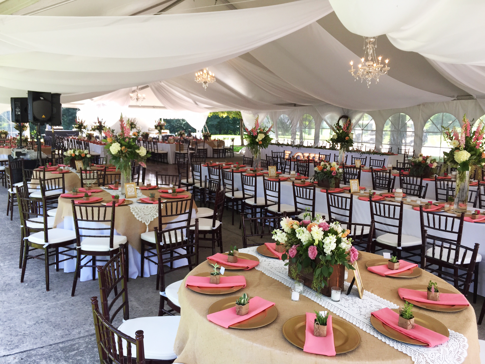 wedding tent with chandeliers and sheer draping in illinois