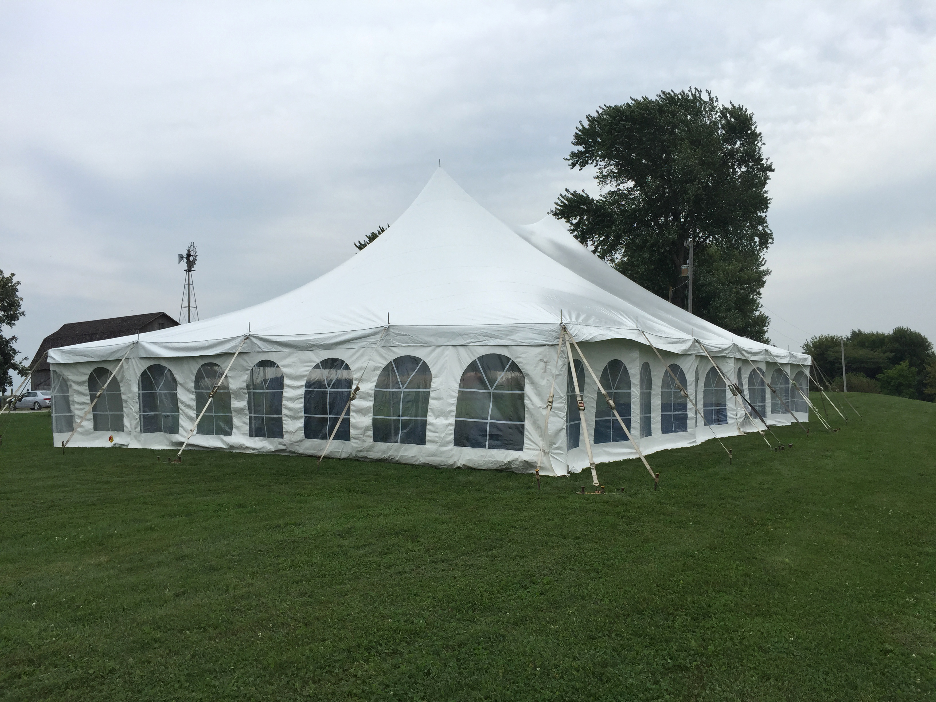 backyard wedding reception under a tent in kalona iowa
