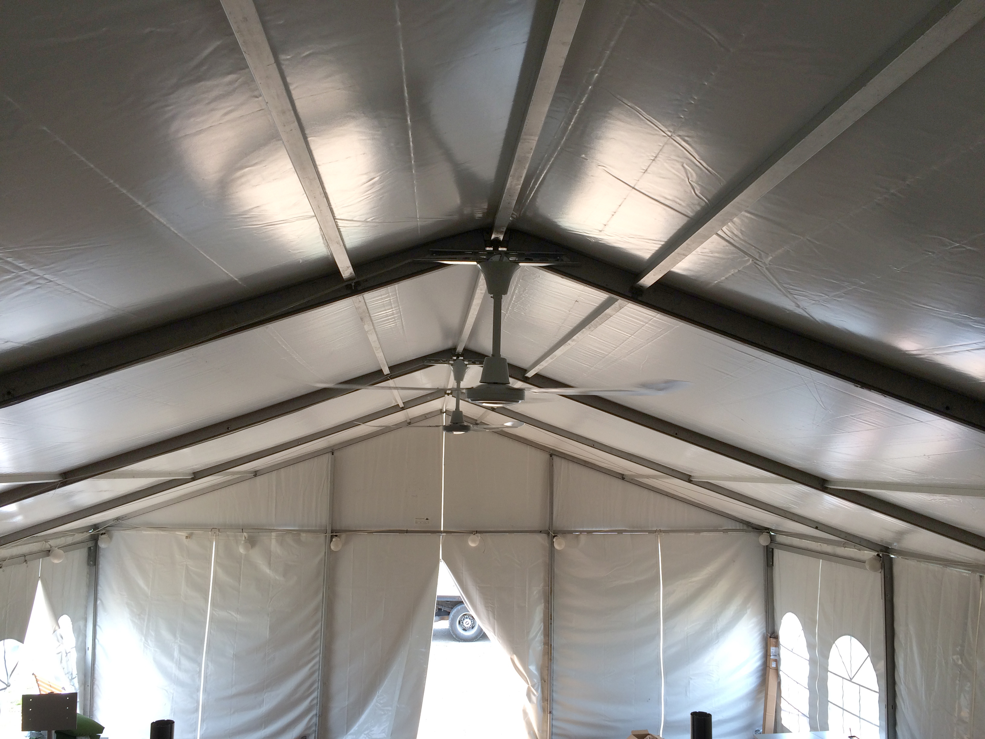Ceiling fan under tentevent structure rental multiple ceiling fans installed on losberger clearspan event tent at the roof peak mozeypictures