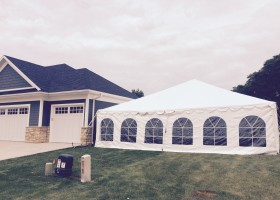 30′ x 60′ frame tent for wedding reception in Dubuque, Iowa next to a home
