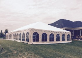 Back of 30′ x 60 frame tent in side yard for wedding reception in Dubuque, Iowa in side yard
