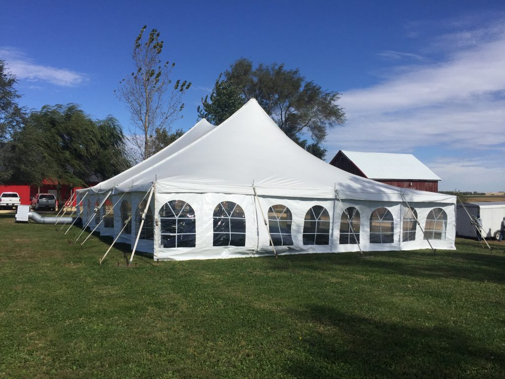 Outside of 40' x 60' rope and pole wedding tent with sidewall in De Witt, Iowa
