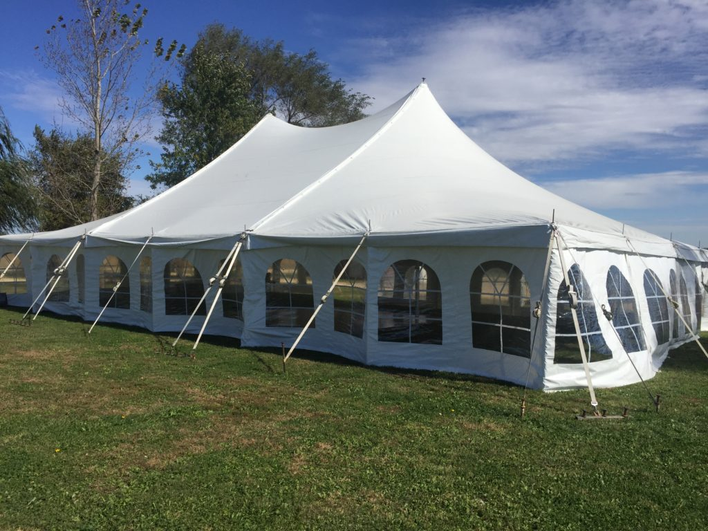 Side of 40' x 60' rope and pole wedding tent with sidewall in De Witt, Iowa
