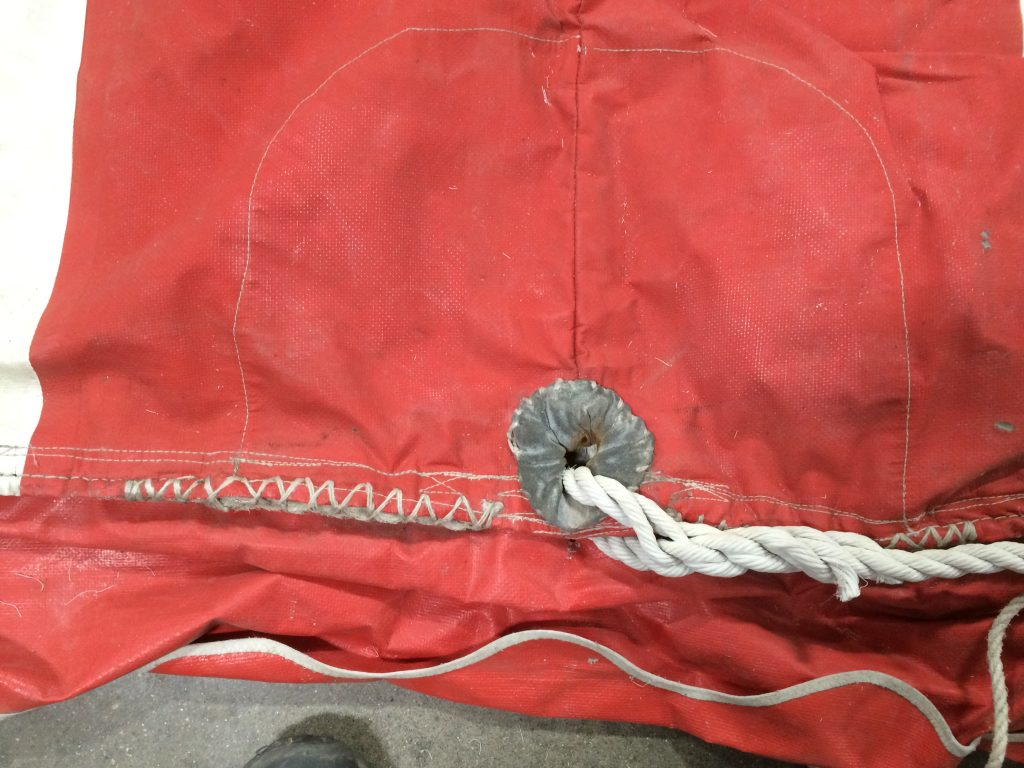 Used Red and White 30' x 60' rope and pole event tent for sale detail of rope