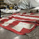 Used Red and White 30' x 60' rope and pole event tent for sale layed out
