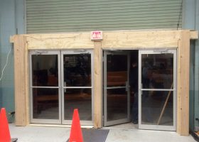 Inside of double glass door fire exits to increase event hall capacity