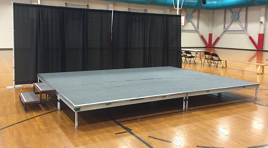 Event stage with stairs at U of I Field House on March 11