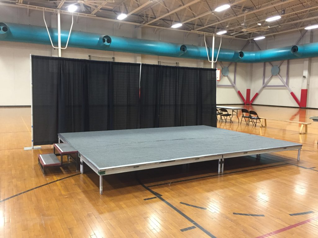 Event stage with stairs at University of Iowa Field House on March 11