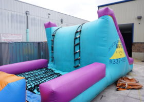 Climb up the ladder on the original inflatable obstacle course
