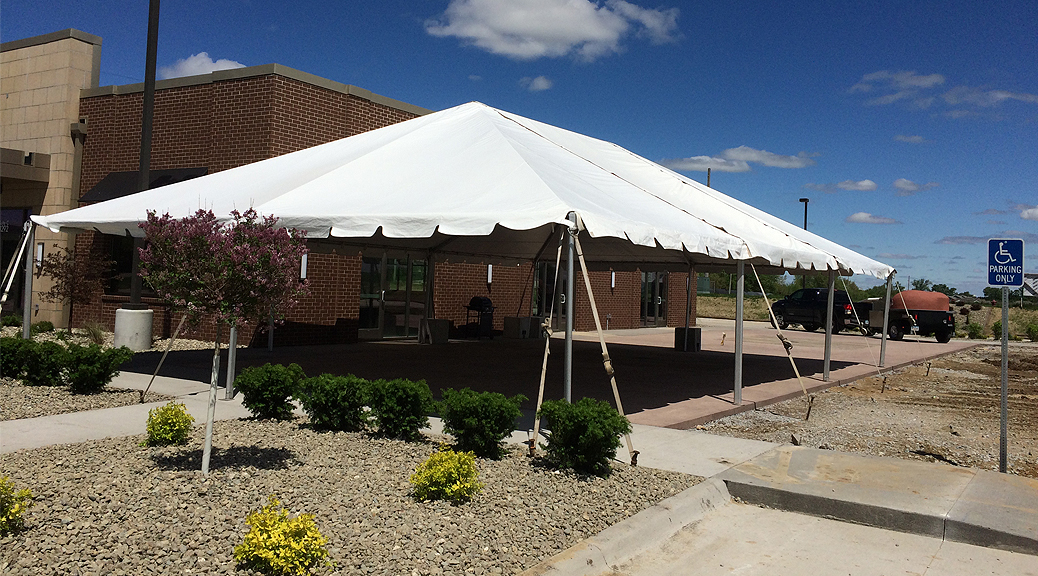 30' x 45' Frame tent between building and a parking lot at Two Rivers Bank & Trust grand opening in Coralville, Iowa