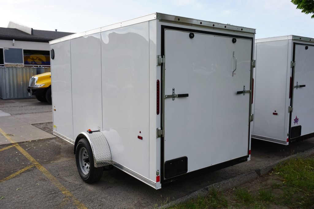 Back door of White 6'x12' enclosed cargo trailer Vin Number 2831