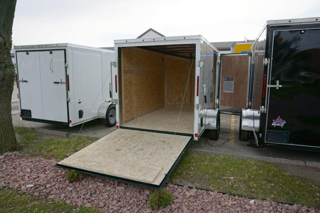 Door open on White 6'x10' enclosed cargo trailer Vin Number 2803