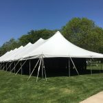 End of the 40' x 160' rope and pole tent for the commencement ceremony at Grinnell College