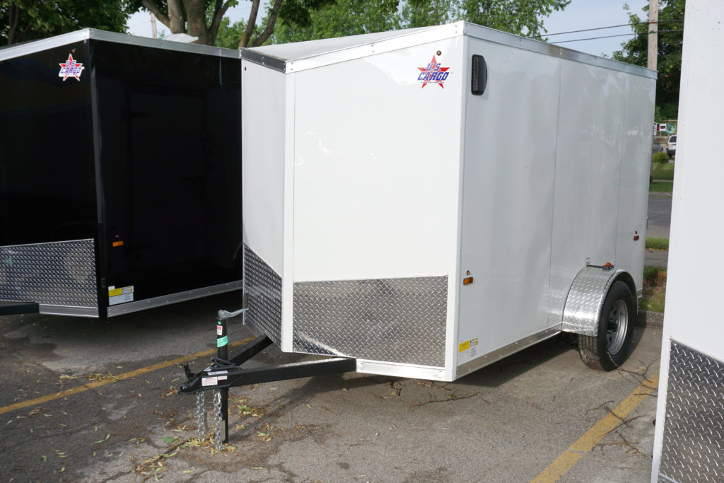 Left side of White 6'x10' enclosed cargo trailer Vin Number 2803