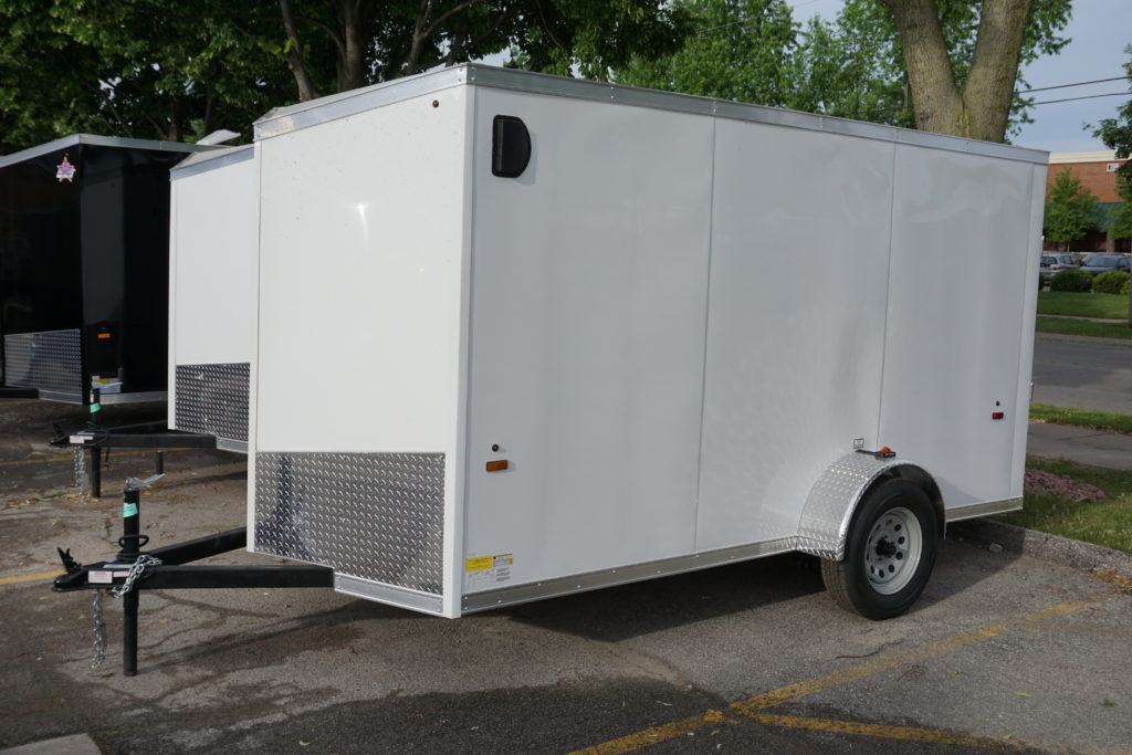 Left side of White 6'x12' enclosed cargo trailer Vin Number 2831