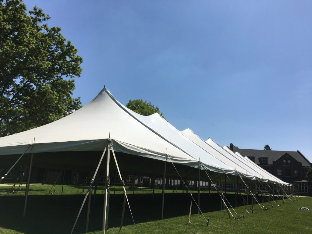 Outside of 40' x 160' rope and pole tent for a commencement ceremony at Grinnell College